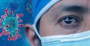 Coronavirus-Darstellung neben einem Auge